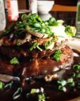 Loco Moco with Portabella Mushroom, grilled onion, sweet onion, gravy and rice